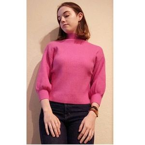 Pink, ribbed, mock neck sweater.